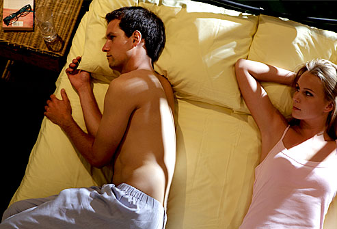getty_rm_photo_of_man_with_low_libido_in_bed_with_woman